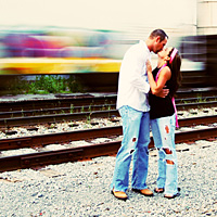 Couple Kissing near railroad tracks